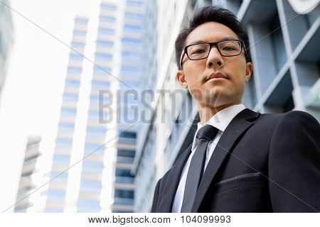 Businessman outdoors in city business district