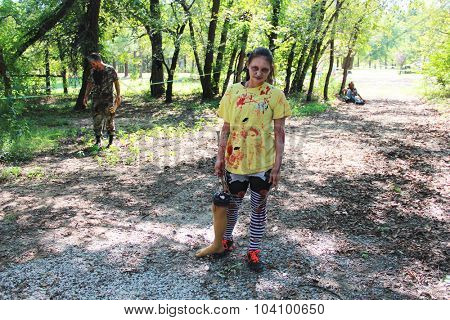 MUSKOGEE, OK - Sept. 12: Bloody zombies roam the forest during the Castle Zombie Run at the Castle of Muskogee in Muskogee, OK on September 12, 2015.