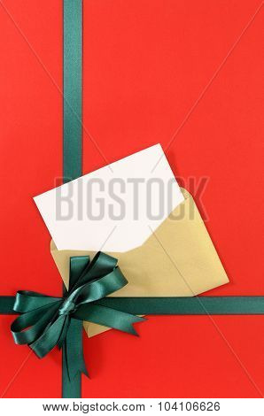 Open Christmas Or Birthday Card With Green Gift Ribbon Bow On Plain Red Background Paper, Copy Space
