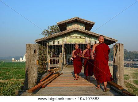 Young Monks Walking On U Bein Bridge