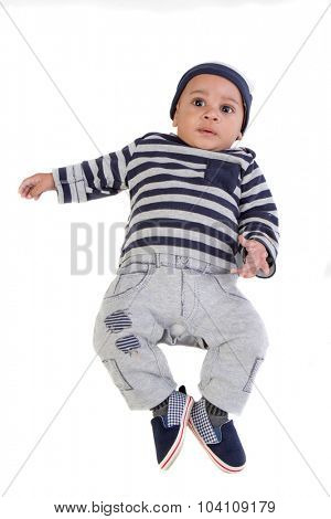 Happy 4 Months Old African American Baby Boy lying down on Isolated Background looking up