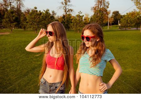 Two Intriguing Sexy Girls Looking At The Sunset