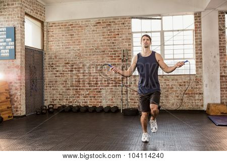 Man skipping wearing sportswear at the gym