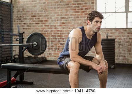 Man sitting on the bench at gym