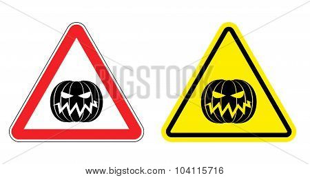 Warning Sign Attention Halloween. Hazard Yellow Sign Terrible Holiday. Evil Pumpkin On  Red Triangle