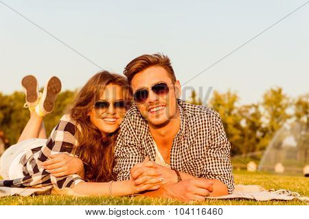 Lovers Lying On The Grass With Glasses