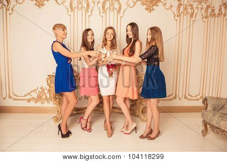 Cheerful Bride With Her Bridesmaids Celebrating Hen-party