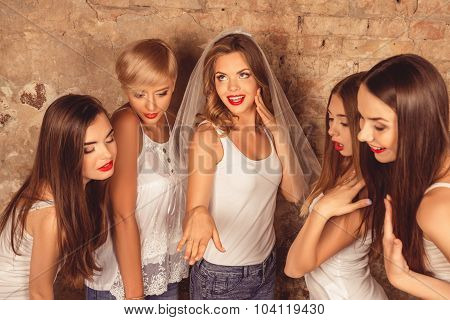 Satisfyed Cute Bride Showing Her Bridesmaids Wedding Ring