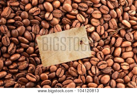 Close-up Of Coffee Beans Background And Blank Tag
