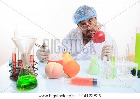 scientist fills chemicals fruit and vegetables