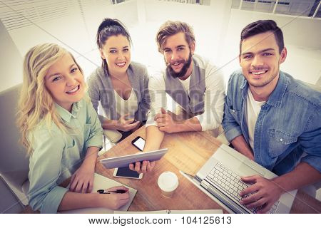 High angle portrait of happy business people while sitting at desk