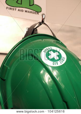 Green helmet of a first aid practitioner