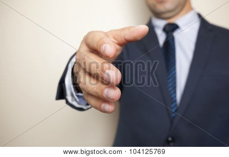 A business man with an open hand ready to greeting