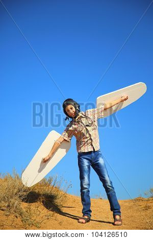 Boy in helmet and flying with wings