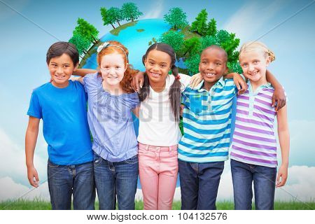 Cute pupils smiling at camera in classroom against blue sky over green field