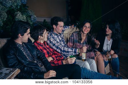 Happy friends drinking and having fun in a party
