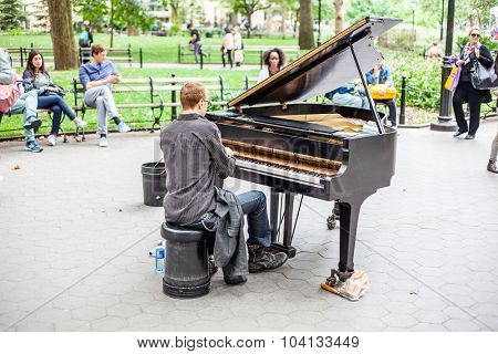 NEW YORK CITY, USA - CIRCA SEPTEMBER 2014: Piano player in Washington Square Park New York City