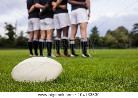 Rugby players standing together before match at the park