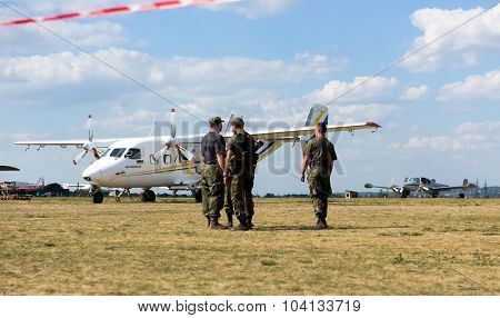 Kharkiv, Ukraine - August 24, 2015: soldiers and plane on airfield Korotych at Kharkiv airshow