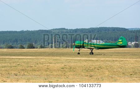 Kharkiv, Ukraine - August 24, 2015: green airplane with propeller on airfield at Kharkiv airshow