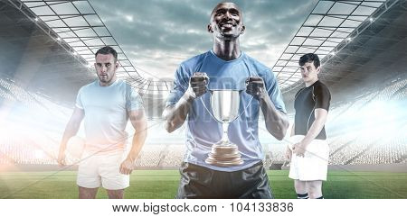Rugby player looking at camera against soccer stadium