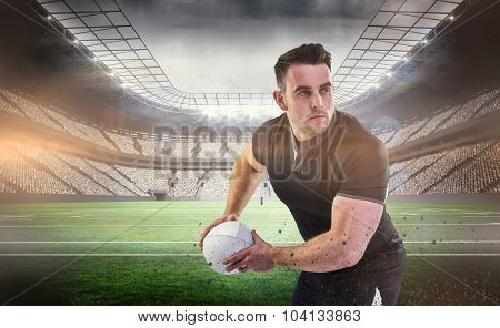 Rugby player throwing the ball against rugby arena