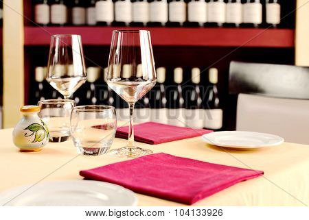 Table Setting For Two Against Wine Cellar