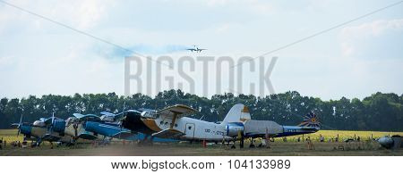 Kharkiv, Ukraine - August 24, 2015: plains on airfield and plane in the sky at Kharkiv airshow