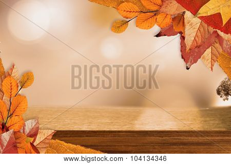 Autumn leaves pattern against overhead of wooden planks