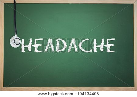 The word headache and stethoscope against chalkboard