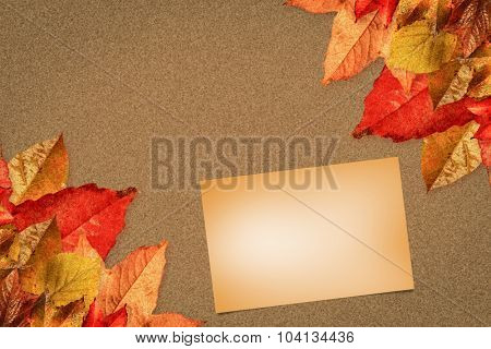 Orange card against autumn leaves pattern