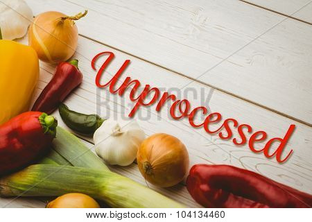 unprocessed against fresh vegetables on table