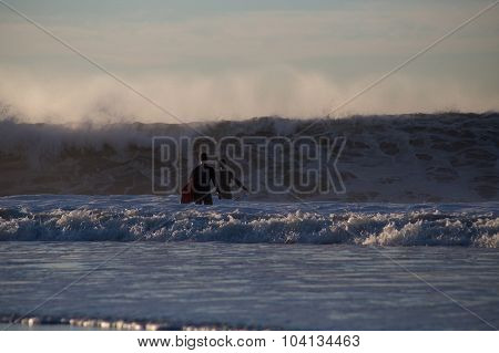 Two Surfers And High Surf