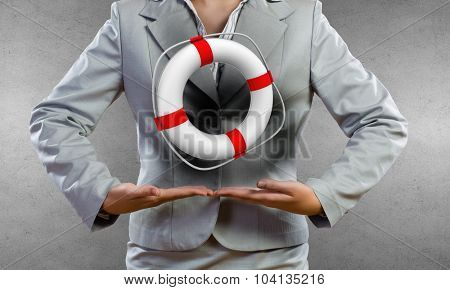 Close up of businesswoman with life buoy in hands