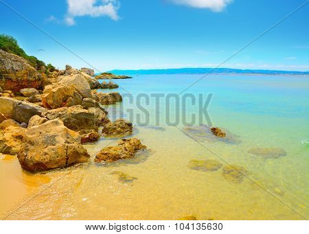 Yellow Rocks And Clear Water