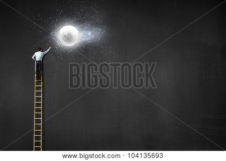 Rear view of businessman standing on top of ladder