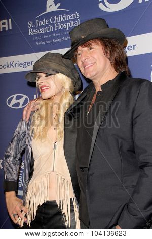 MOORPARK, CA - OCT 5: Orianthi and Richie Sambora arrive at the 8th Annual Medlock/Krieger Invitational Golf Concert at the Moorepark Country Club in Moorpark, CA on October 5, 2015.