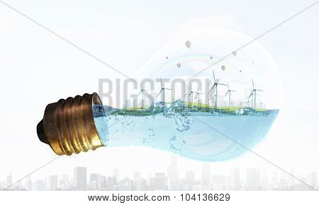 Eco energy concept with windmills inside of light bulb