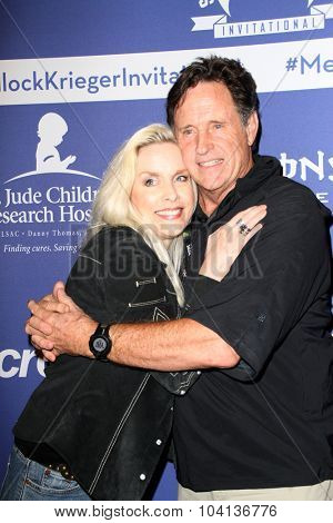 MOORPARK, CA - OCT 5: Cherie Currie and Robert Hays arrive at the 8th Annual Medlock/Krieger Invitational Golf Concert at the Moorpark Country Club in Moorpark, CA on October 5, 2015.