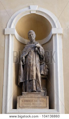 LJUBLJANA, SLOVENIA - JUNE 30: Saint Thomas Aquinas on the facade of St Nicholas Cathedral in the capital city of Ljubljana, Slovenia on June 30, 2015