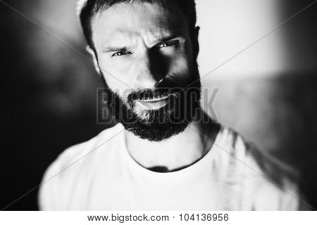 BW portrait of a man wearing white tshirt on the blure background