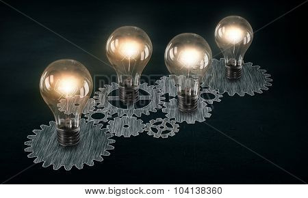 Glowing light bulbs and gears mechanism on dark background
