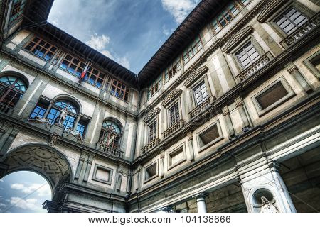 Uffizi Gallery Under A Cloudy Sky In Florence