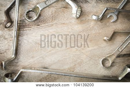 Wrench Tools On Wood Background