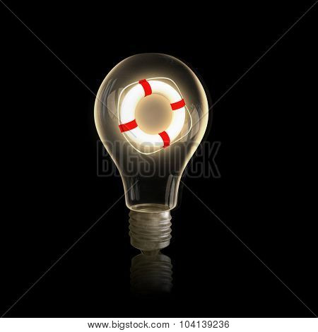 Light bulb with life buoy on black bakground