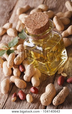 Aromatic Natural Peanut Oil In A Glass Jar Close Up On The Table Vertical