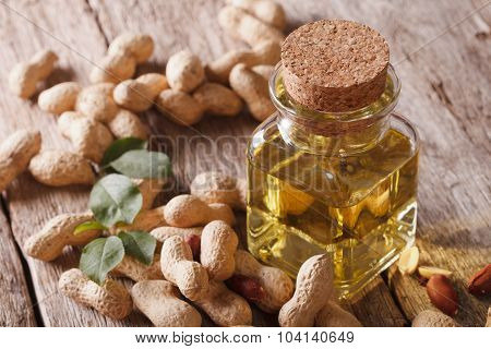 Natural Peanut Oil In A Glass Jar Close Up. Horizontal
