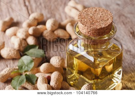 Peanut Oil In A Glass Bottle On A Table Macro. Horizontal
