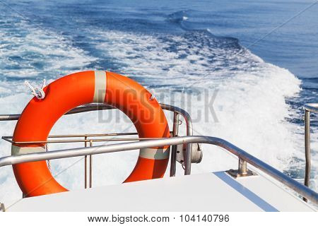 Red Lifebuoy Hanging On Stern Of Motorboat
