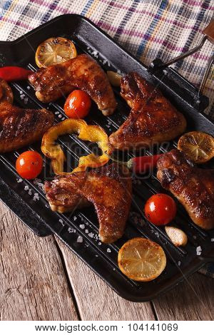 Grilled Chicken Wings With Vegetables In A Grill  Pan Close-up. Vertical
